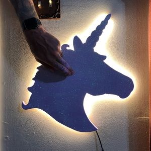 Unicorn themed wooden wall art with LED lights.